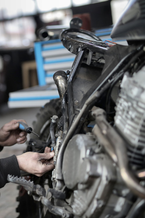 Motorcycle engine being serviced